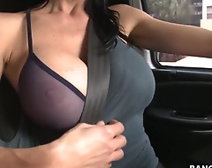 this babe is ready for something really spicy and while driving the auto shows off her nice juicy boobs, how awesome they look in this top and bra, give it off, babe for better look!