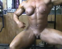 Powerful naked bodybuilder shows her big love button in the gym