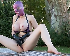 Unconventional Latex Lucy, wearing a whole-head rubber mask, whips out say no to chunky boobs, and masturbates outdoors in a swimming pool in this hot solo masturbation innings from DDF Productions' Latex Lucy The British Dominatrix.