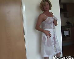 Busty mature babe in lingerie and nylons strips