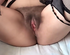My 58 year old Latina wife shows her hairy pussy close-up
